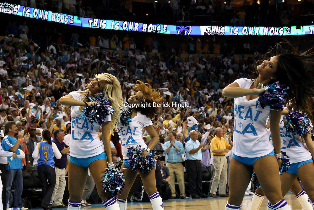 April 24, 2011; New Orleans, LA, USA; New Orleans Hornets Honeybees perform in the fourth quarter in game four of the first round of the 2011 NBA playoffs against the Los Angeles Lakers at the New Orleans Arena. The Hornets defeated the Lakers 93-88.   Mandatory Credit: Derick E. Hingle