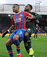 Football - 2019 / 2020 Premier League - Crystal Palace vs. Newcastle United<br /> <br /> Jordan Ayew of Palace is closely marked by Danny Rose of Newcastle , at Selhurst Park.<br /> <br /> COLORSPORT/ANDREW COWIE
