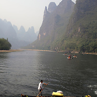 Asia, China, Guilin. Rafting along the scenic Li River.