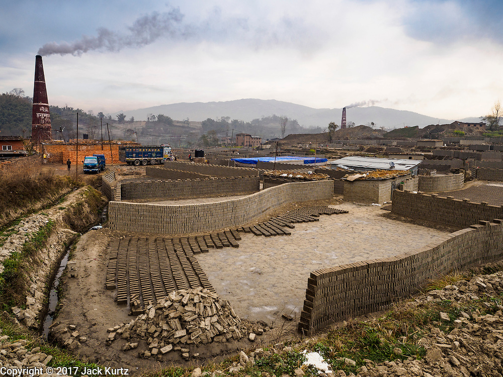 03 MARCH 2017 - BAGMATI, NEPAL: Brick factories in Bagmati, near Bhaktapur. There are almost 50 brick factories in the valley near Bagmati. The brick makers are very busy making bricks for the reconstruction of Kathmandu, Bhaktapur and other cities in the Kathmandu valley that were badly damaged by the 2015 Nepal Earthquake. The brick factories have been in the Bagmati area for centuries because the local clay is a popular raw material for the bricks. Most of the workers in the brick factories are migrant workers from southern Nepal.       PHOTO BY JACK KURTZ