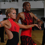 Same-sex ballroom dancers Jeannette Green, right, and Lorraine Vickers, of Reading, England, compete in the women's latin competition at the 5 Boro Dance Challenge on May 5, 2007...The locally produced 5 Boro Dance Challenge, New York City's first major same-sex dance competition, was held at the Park Central Hotel in Manhattan from May 4-6, 2007. .