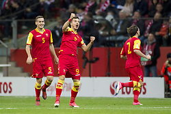 October 8, 2017 - Warsaw, Poland - Stefan Mugosa (9) of Montenegro celebrates with his team-mate during the FIFA World Cup 2018 Qualifying Round Group E match between Poland and Montenegro at National Stadium in Warsaw, Poland on October 8, 2017  (Credit Image: © Andrew Surma/NurPhoto via ZUMA Press)