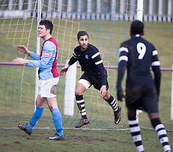 Ibrahim Diallo scores for Edusport Academy past keeper Young.<br /> half time : Whitehill Welfare 1 v 1 Edusport Academy, South Challenge Cup Quarter Final played 7/3/2015 at Ferguson Park, Carnethie Street, Rosewell.
