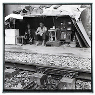 Black and white portrait of a Vietnamese couple living along the railway of Hanoi, Vietnam, Southeast Asia