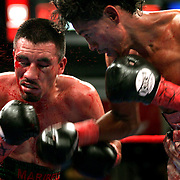 Tomas Rojas, right, connects a punch to the face of Luis Maldonado during the fifth round of their 10-round super flyweight match at the Dodge Arena on Saturday night. Maldonado recovered to win the bout in a split decision.<br /> Nathan Lambrecht/The Monitor