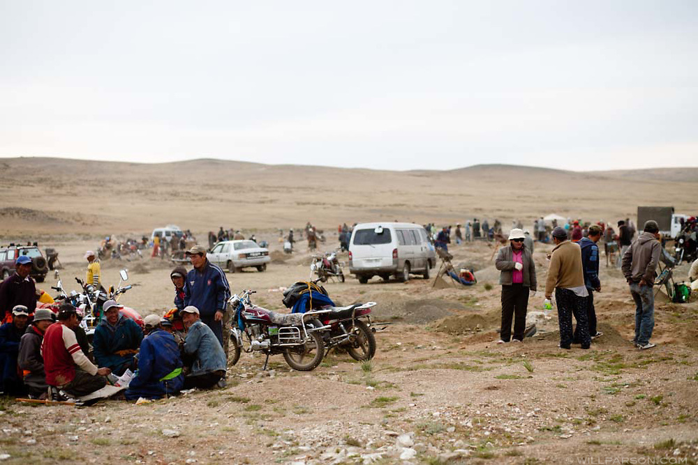 Workers sift soil at a mining site in Govi-Altai Province, Mongolia.