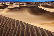 Shadows and patterns in the sand in Death Valley National Park in California's desert