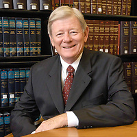 Attorney Kelly Frels poses in the law library in his office building.  Frels has been honored for his work as education lawyer and received a lifetime achievement award.   (Photo by Kim Christensen)