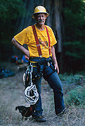 Gerald Beranek, one of California's best known recreational tree climbers at the site of the Henry Tree near Boonville, California.  Also pictured with his dog, Peewee.