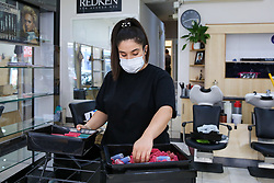 © Licensed to London News Pictures. 30/06/2020. London, UK. A member of staff in Cheriee on Green Lanes in Harringay, north London, cleans hair rollers as Cheriee prepares to reopen on 4 July. Hairdressers across the UK closed on 23 March following the coronavirus lockdown. As coronavirus lockdown restrictions are eased, hairdressers will reopen on Saturday 4 July. Photo credit: Dinendra Haria/LNP