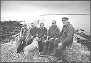 The completed fly net which is stationed on the rocks at Boddin, Angus viewed at high tide and has just been constructed by this team of five salmon netters, led by Ian Falconer (right).<br /> Ref. Catching the Tide 29/00/22 (6th May 2000)<br /> <br /> The once-thriving Scottish salmon netting industry fell into decline in the 1970s and 1980s when the numbers of fish caught reduced due to environmental and economic reasons. In 2016, a three-year ban was imposed by the Scottish Government on the advice of scientists to try to boost dwindling stocks which anglers and conservationists blamed on netsmen.