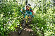Pip Hunt mountain bikes at Park City Mountain Resort in Park City, UT. © Brett Wilhelm