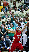 SHOT 2/23/10 9:40:48 PM - Colorado State's Andy Ogide battles New Mexico's Darington Hobson for a long rebound during the first half of their regular season Mountain West Conference game at Moby Arena in Fort Collins, Co. New Mexico survived a tight game winning 72-66. (Photo by Marc Piscotty / © 2010)