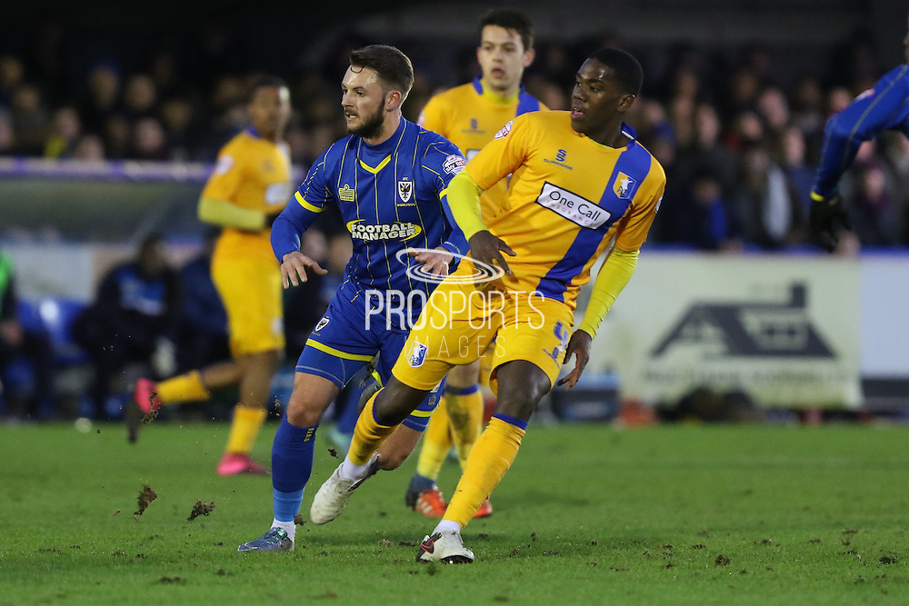 Callum Kennedy of AFC Wimbledon in action  during the Sky Bet League 2 match between AFC Wimbledon and Mansfield Town at the Cherry Red Records Stadium, Kingston, England on 16 January 2016. Photo by Stuart Butcher.