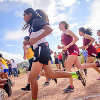 The Girls varsity round the first turn during the Rehoboth Invitational cross country meet in Rehoboth Friday.