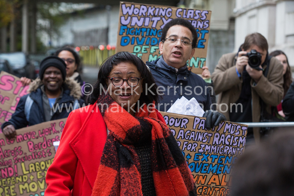 London, UK. 16 November, 2019. Diane Abbott, Shadow Home Secretary, passes freedom of movement activists from Movement for Justice as she arrives at Labour's Clause V meeting. The Clause V meeting, chaired by the party leader and attended by members of the National Executive Committee (NEC), relevant Shadow Cabinet members and members of the National Policy Forum, will finalise the party's general election manifesto. The meeting is named after Clause V of the Labour Party rulebook.