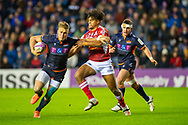 Duhan van der Merwe (#11) of Edinburgh Rugby tries to break the tackle of Sam Vaka (#22) of SU Agen Rugby during the European Rugby Challenge Cup match between Edinburgh Rugby and SU Agen at BT Murrayfield, Edinburgh, Scotland on 18 January 2020.