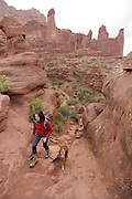 SHOT 5/7/16 10:23:17 AM - Moab is a city in Grand County, in eastern Utah, in the western United States. Moab attracts a large number of tourists every year, mostly visitors to the nearby Arches and Canyonlands National Parks. The town is a popular base for mountain bikers and motorized offload enthusiasts who ride the extensive network of trails in the area. Includes images of Scenic Byway 128, Fisher Towers and downtown Moab. (Photo by Marc Piscotty / © 2016)