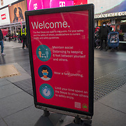 Signage to remind people to social distance is placed in Times Square for the Holiday season during the Coronavirus (Covid-19) outbreak in Manhattan,New York on Sunday, December 6, 2020. (Alex Menendez via AP)