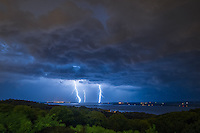 Early in the morning a very active lightning storm passed by north of Peoria. An overlook on Grandview Drive was the perfect place to watch it approach. The overlook sits on a bluff 300 feet above the Illinois River. This is the part of the river where it widens and forms Peoria Lake. It was raining heavily with plenty of lightning bolts striking on the opposite side of the river. But from where I was it stayed dry enough to take over 400 pictures.<br /> <br /> Date Taken: 9/3/2014