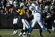 Oakland Raiders quarterback Derek Carr (4) looks for an open receiver against the Indianapolis Colts at Oakland Coliseum in Oakland, Calif., on December 24, 2016. (Stan Olszewski/Special to S.F. Examiner)