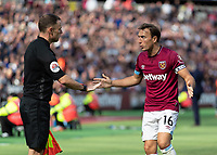 Football - 2018 / 2019 Premier League - West Ham United vs. Manchester United<br /> <br /> Mark Noble (West Ham United) questions the linesman over a decision at the London Stadium<br /> <br /> COLORSPORT/DANIEL BEARHAM