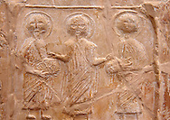 Detail of a 6th-7th Century Eastern Roman Byzantine  Christian Terracotta tiles depicting Christ changing Water into wine - Produced in Byzacena -  present day Tunisia. <br /> <br /> These early Christian terracotta tiles were mass produced thanks to moulds. Their quadrangular, square or rectangular shape as well as the standardised sizes in use in the different regions were determined by their architectonic function and were designed to facilitate their assembly according to various combinations to decorate large flat surfaces of walls or ceilings. <br /> <br /> Byzacena stood out for its use of biblical and hagiographic themes and a richer variety of animals, birds and roses. Some deer and lions were obviously inspired from Zeugitana prototypes attesting to the pre-existence of this province's production with respect to that of Byzacena. The rules governing this art are similar to those that applied to late Roman and Christian art with, in the case of Byzacena, an obvious popular connotation. Its distinguishing features are flatness, a predilection for symmetrical compositions, frontal and lateral representations, the absence of tridimensional atti-tudes and the naivety of some details (large eyes, pointed chins). Mass production enabled this type of decoration to be widely used at little cost and it played a role as ideograms and for teaching catechism through pictures. Painting, now often faded, enhanced motifs in relief or enriched them with additio-nal details to break their repetitive monotony.<br /> <br /> The Bardo National Museum Tunis, Tunisia