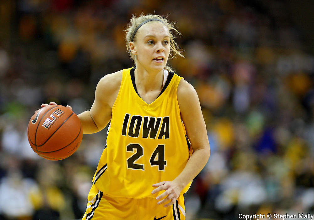 January 08 2010: Iowa guard Jaime Printy (24) with the ball during the first half of an NCAA womens college basketball game at Carver-Hawkeye Arena in Iowa City, Iowa on January 08, 2010. Iowa defeated Ohio State 89-76.