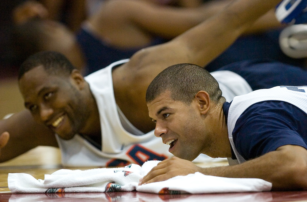 usabsktball  (7/22/06)  Elton Brand (cq), left, and Shane Battier (cq), right, stretch during practice for the USA Senior National Team's training camp at Cox Pavilion in Las Vegas, Saturday, July 22, 2006.  Photo by David Calvert/The Arizona Republic<br />