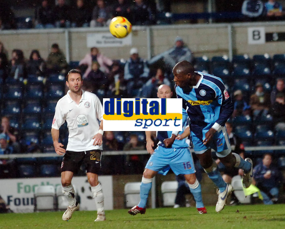 Photo: Kevin Poolman.<br />Wycombe Wanderers v Hereford United. Coca Cola League 2. 01/01/2007. Wycombe's Fola Onibuje comes close with this header.