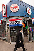 Brooklyn, NY 5 April 2020. Penny Lane, a discount store that had just opened on Avenue J and E 16th Street in Brooklyn's Midwood neighborhood, is closed as a result of COVID-19. Signs sadly announce the store's grand opening.