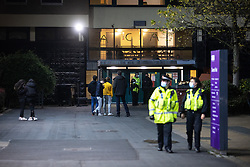 © Licensed to London News Pictures. 12/11/2020. Manchester, UK. Police at the University of Manchester's Owens Park campus this evening (12th November 2020) in front of the occupied Owens Park Tower . Students have taken part in a demonstration at the site in support of those who have occupied Owens Park Tower as part of a rent strike at the University . Students object to rent payments for reduced facilities , the University's erection of fencing around the campus and what they describe as the UoM's failure to provide adequate mental health and wider support . Photo credit: Joel Goodman/LNP
