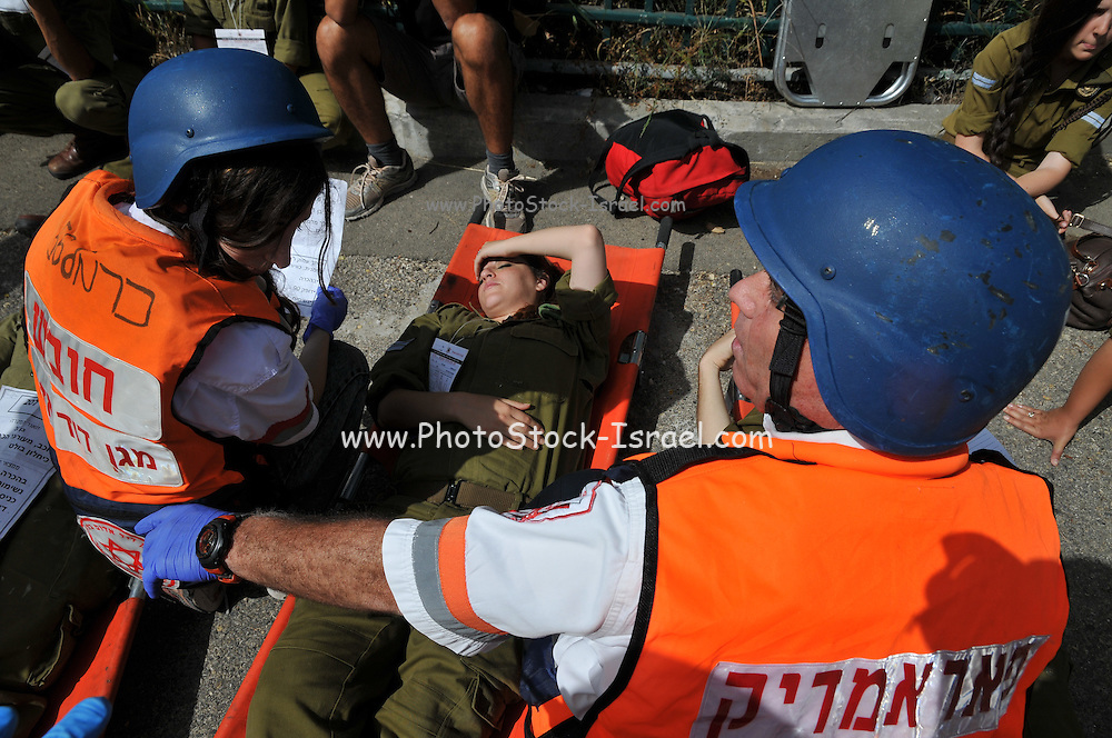 Israel, Haifa Israeli security forces and rescue personnel attend an exercise simulating a terror attack in Haifa home front. Wounded people being treated by first aid crew