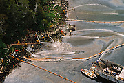 Alaska. Prince William Sound. Maxi barge provides water pressure to scour a Snug Harbor beach.