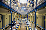 A view along wing A of Wandsworth prison. This wing has the suicide netting between each floor. HMP Wandsworth in South West London was built in 1851 and is one of the largest prisons in Western Europe. It has a capacity of 1456 prisoners.