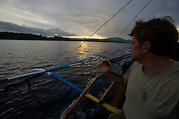 Tim Laman travels by pumpboat along the coast of Halmahera between sites searching for Wallace's Standardwing Bird of Paradise.