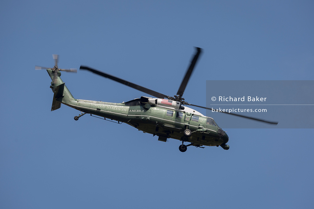 Marine One flies over a temporary perimeter fence encircling Winfield House, the official residence of the US Ambassador during the visit to the UK of US President, Donald Trump, on 12th July 2018, in Regent's Park, London, England.
