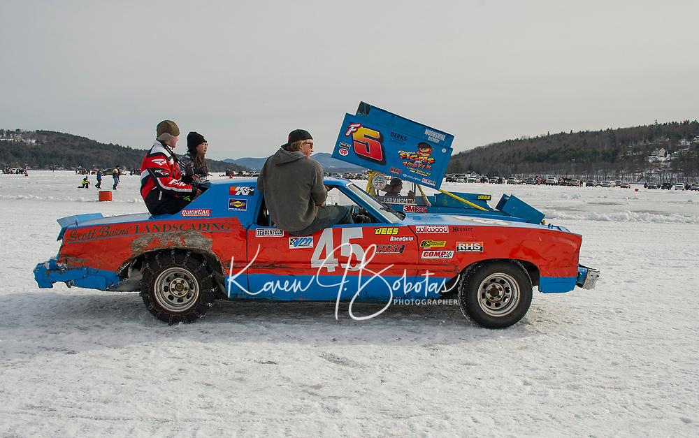 Cody Burns in #45 Stock class with his crew and Fabian Smith in #5 Modified class drive over to the start area for the afternoon feature races during Sunday's Latchkey Cup Nostalgic Race on Meredith Bay.   (Karen Bobotas/for the Laconia Daily Sun)