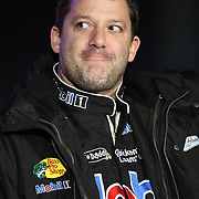 NASCAR Sprint Cup driver Tony Stewart (14) is seen during the driver introductions prior to the NASCAR Sprint Unlimited Race at Daytona International Speedway on Saturday, February 16, 2013 in Daytona Beach, Florida.  (AP Photo/Alex Menendez)