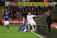 Swansea city's Jonjo Shelvey is tackled by Leicester's Riyad Mahrez as Swansea city manager Garry Monk looks on. Barclays Premier league match, Swansea city v Leicester city at the Liberty stadium in Swansea, South Wales on Saturday 25th October 2014<br /> pic by Andrew Orchard, Andrew Orchard sports photography.