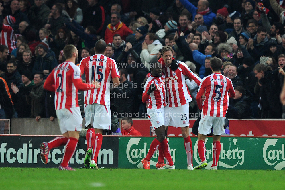 Peter Crouch of Stoke city celebrates with teammates after he scores his teams 1st goal to make it 1-1. . Barclays Premier League match, Stoke city v Manchester city at the Britannia Stadium in Stoke on Trent , Staffs on Wed 11th Feb 2015.<br /> pic by Andrew Orchard, Andrew Orchard sports photography.