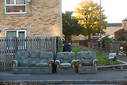 Three piece suite discarded out on the street in a housing estate in Balsall Heath in Birmingham, United Kingdom. Balsall Heath is a working class, inner-city area of Birmingham, West Midlands, England.