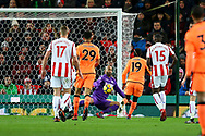 Sadio Mane of Liverpool (19) places the ball past Stoke City Goalkeeper Lee Grant to score his teams 1st goal. Premier league match, Stoke City v Liverpool at the Bet365 Stadium in Stoke on Trent, Staffs on Wednesday 29th November 2017.<br /> pic by Chris Stading, Andrew Orchard sports photography.