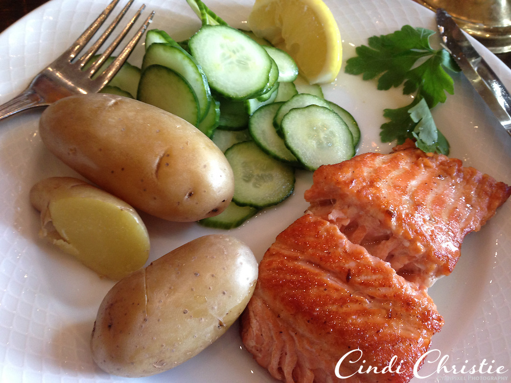 Norwegian trout is served with boiled potatoes and cucumber at Bryggestuene restaurant in the Bryggen area of Bergen, Norway, on May 22, 2013. Bryggestuen is at the ground floor, while Bryggelofet is on the upper level.  (© 2013 Cindi Christie)