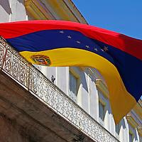 Central America, Cuba, Havana. Venezuela flag flies from balcony in Havana, Cuba.