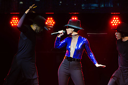 "© Licensed to London News Pictures. 30/05/2013. London, UK.   Alicia Keys performing live at The O2 Arena as part of her ""Girl on Fire Tour"" - here she enacts a dance sequence involving male dancers seemingly playing the parts of predators.   Alicia Keys is an American pianist, R&B singer-songwriter,musician,record producer and actress. She is touring to promote her fifth studio album ""Girl on Fire"". Photo credit : Richard Isaac/LNP"