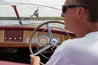 "Steve Clark cruises around Cow Island on Lake Winnipesaukee in his 19' 1949 Century ""Maiden '49"".  ©2018 Karen Bobotas Photographer"