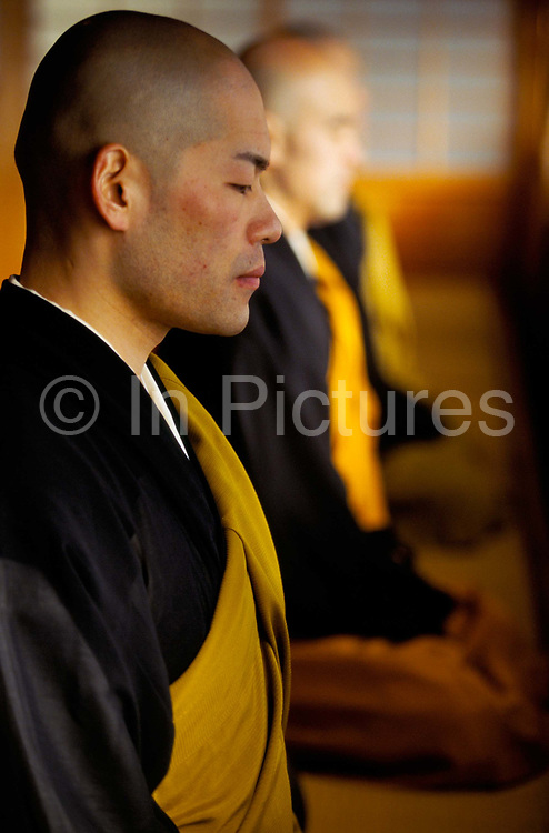 "Zen monks of the Soto School meditate at the Seiryu-ji Temple in Hikone City, Japan.Sitting Zen (or Zazen) is at the heart of Buddhist practice in Japan..In Zen Buddhism, zazen (literally ""seated meditation"") is a meditative discipline practitioners perform to calm the body and the mind and experience insight into the nature of existence and thereby gain enlightenment (satori)"