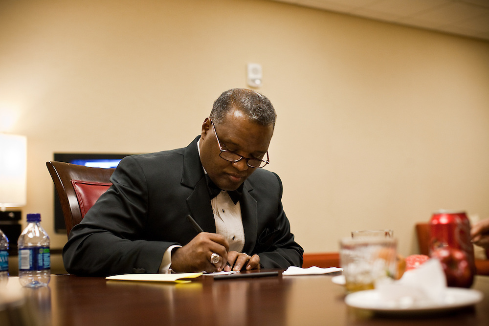 NATIONAL HARBOR, MD - DECEMBER 6: Prince George's County Executive-Elect Rushern Baker III writes on a napkin before speaking during the inaugural ball at Gaylord National Convention on December 6, 2010 in National Harbor, Maryland. (Photo by Michael Starghill, Jr.)