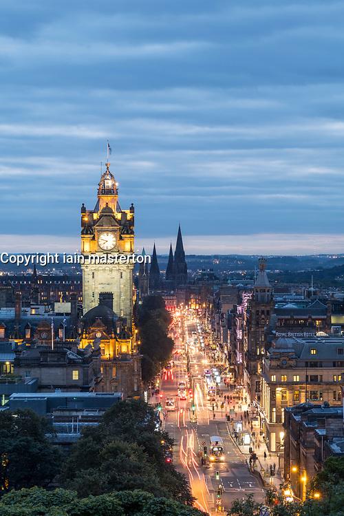 View along busy Princes Street at dusk in Edinburgh, Scotland, United Kingdom.